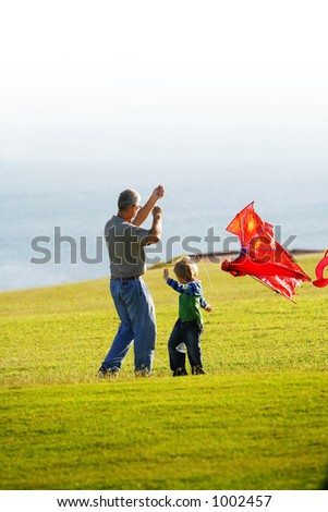 Father & son flying kite - stock photo