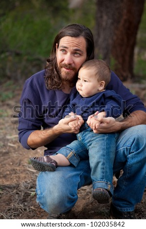 Father & son having a day of fun in the nature - stock photo