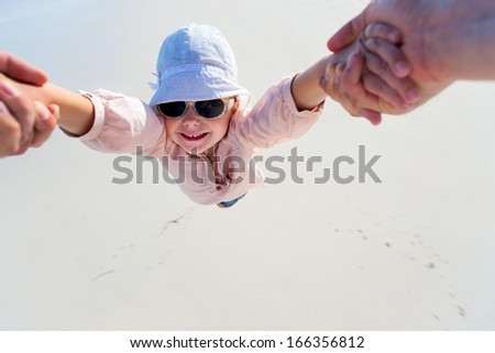 Father spinning around his adorable little daughter  - stock photo