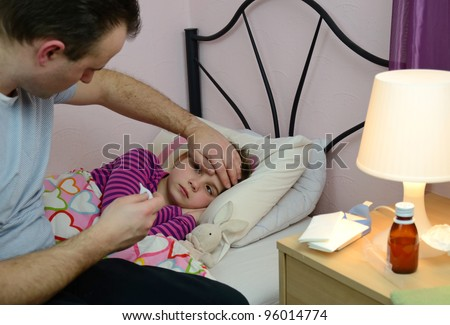 Father take care of sick daughter - stock photo