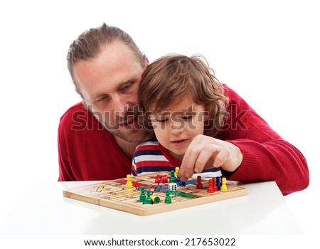Father teaching his son playing board game - stock photo