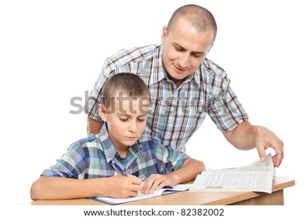 Father verifying son's homework, isolated on white background - stock photo