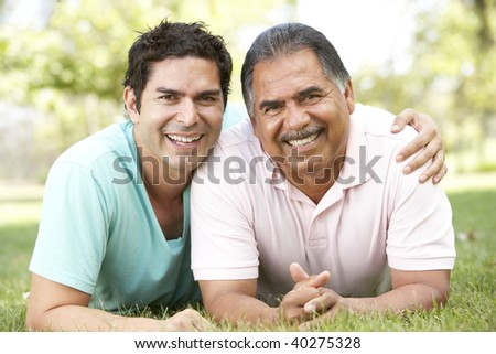 Father With Adult Son In Park - stock photo