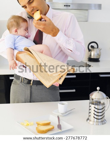 Father with children in kitchen - stock photo
