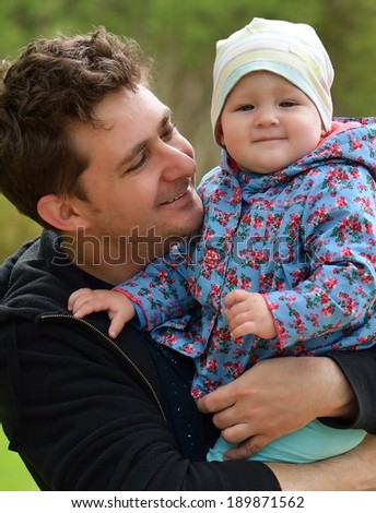 Father with his baby in park.