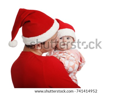 Father with his baby in Santa hat celebrating Christmas. In Studio on white background isolated