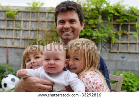 father with his daughters and baby son - stock photo