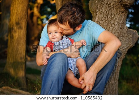 Father with his son in a park - stock photo