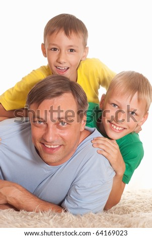 father with his two sons on a white