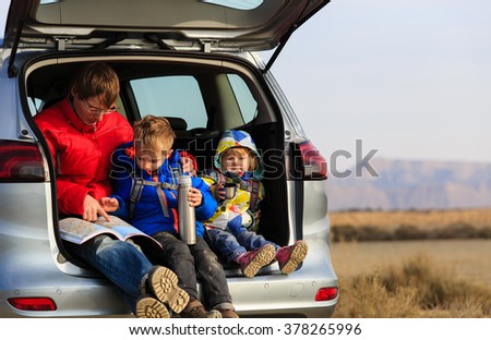 father with kids travel by car in mountains