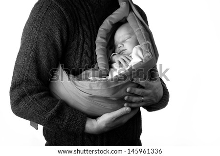 Father with little baby in a sling, black and white  - stock photo