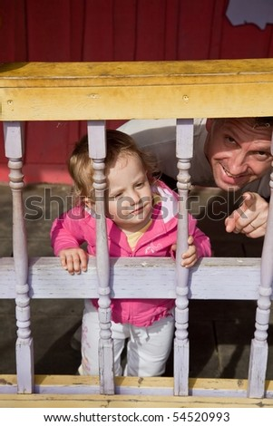 Father with little daughter exploring outdoors together. - stock photo