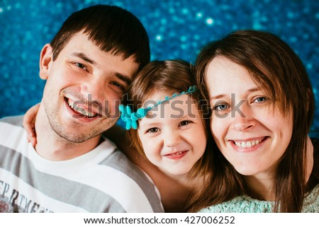 Father with mother and their lovely daughter - stock photo