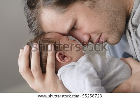 Father with newborn baby - stock photo