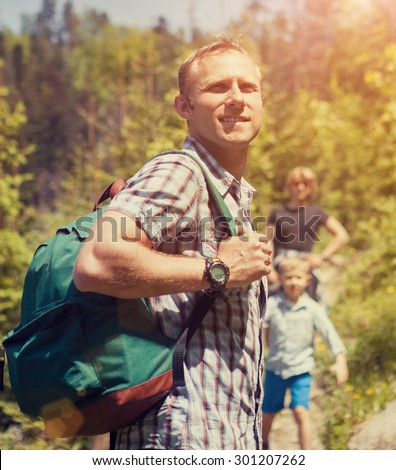 Father with sons holiday walk in mountain - stock photo