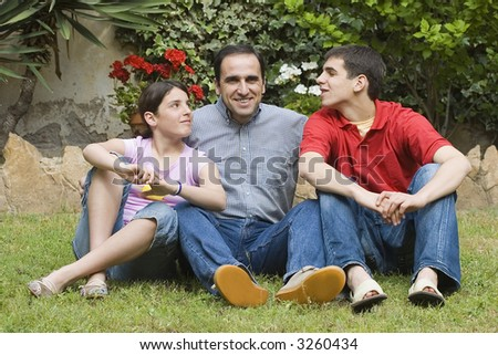 Father with teenager son and daughter - stock photo