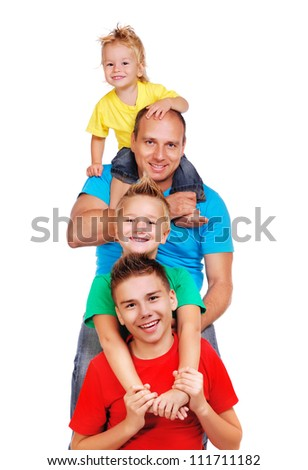 Father with three sons making pyramid