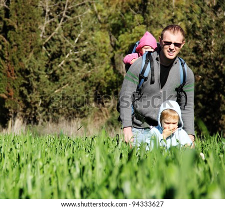 Father with two kids outdoors - stock photo