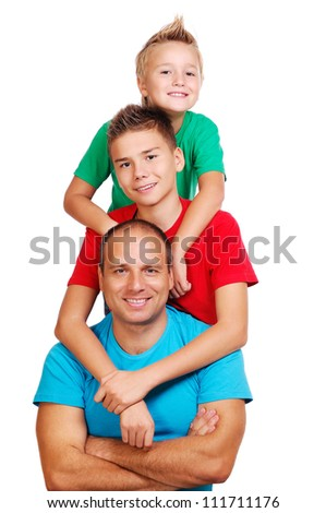 Father with two sons on white background making pyramid - stock photo