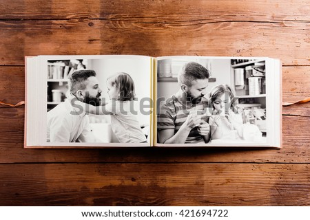 Fathers day composition. Photo album, black-and-white pictures. - stock photo