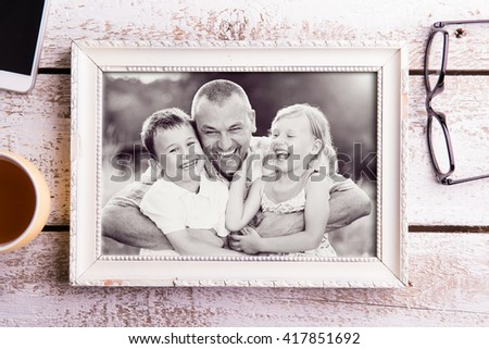 Fathers day composition. Picture of father with children in fram - stock photo