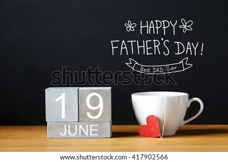Fathers Day message with coffee cup with wooden blocks - stock photo