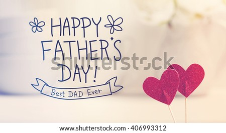 Fathers Day message with small red hearts with white dishes - stock photo