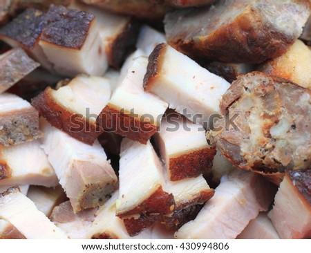 Fatty bacon and sausage closeup - stock photo