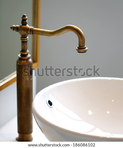 Faucet and sink close up shot for background mirror