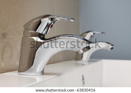faucet and sink - modern bathroom close-up - stock photo