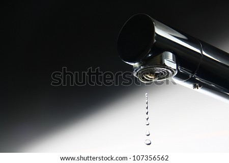 Faucet Drop of Water drama - stock photo