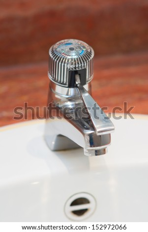 faucet in hotel room - stock photo