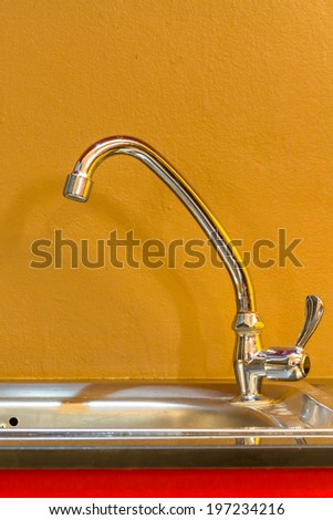 Faucet in the kitchen for wash - stock photo