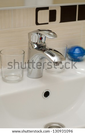 Faucet in the modern bathroom - stock photo