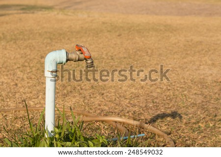 faucet of garden in drought - stock photo