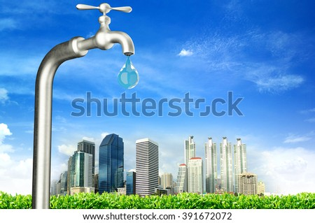 faucet with water drop and city - stock photo