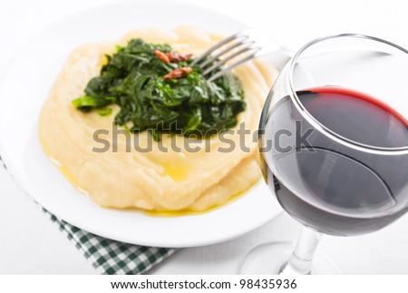 Fava bean puree with spinach. Pur���¨ di fave e spinaci. - stock photo