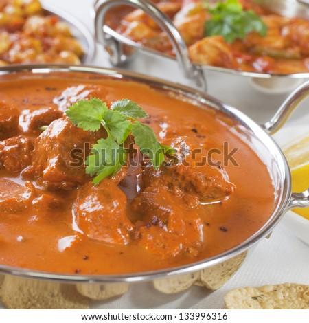 Favourite Indian curry Rogan Josh with poppadums. - stock photo