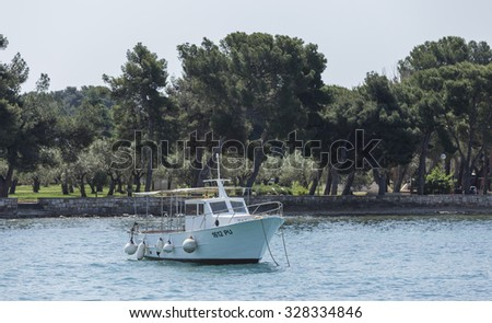 FAZANA, CROATIA - MAY 2015 - Taxi boat at the Adriatic Sea, in Croatia.