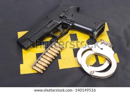 fbi concept with gun ammo and handcuffs - stock photo