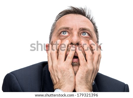 Fear and horror. Portrait of an middle age man with face closed by hands. Isolated on white  - stock photo