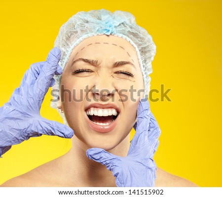 fear, crying, anger. young woman before surgery - stock photo