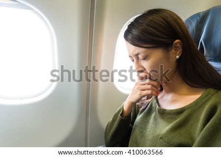 Fear of flying woman in plane airsick - stock photo
