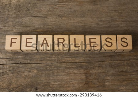FEARLESS text on a wooden background - stock photo