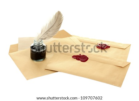 feather, ink and old letters isolated on white