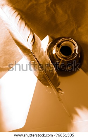 Feather, ink bottle and envelope - stock photo