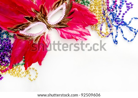 feather mask and beads for mardi gras - stock photo
