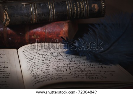 Feather, old books and manuscript - stock photo