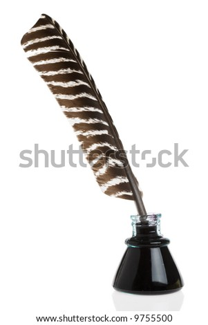Feather Quill and ink well isolated on white background