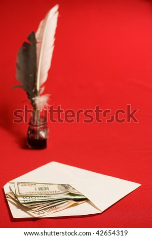 Feather quill, ink and money in envelope - stock photo